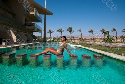 The model poses near pool 2