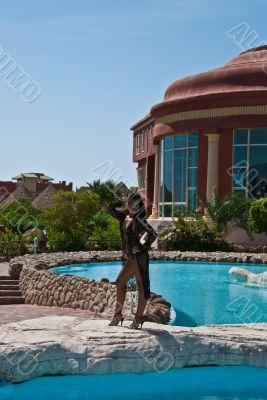 The beautiful model poses near pool