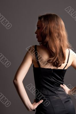 back of young sexy female with turned head