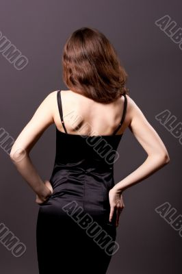 back of young sexy female standing turned