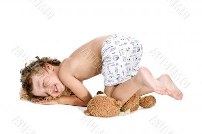sleeper little boy with toy bear