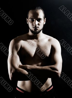 Muscular man over black