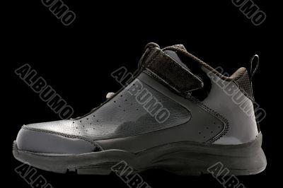 Sport shoes on black closeup