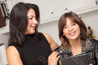 Attractive Hispanic Proud Mom with Her Pretty Schoolgirl Daughte