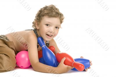 little boy play toy skittles