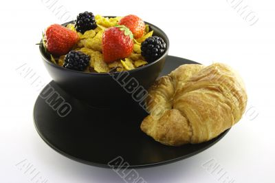 Cornflakes in a Black Bowl with a Croissant