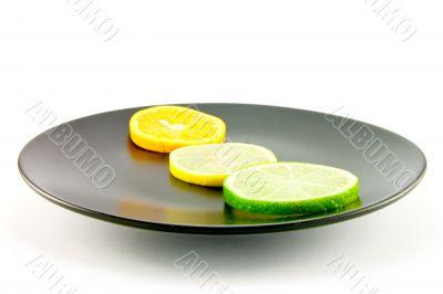 Citrus Slices on a Black Plate