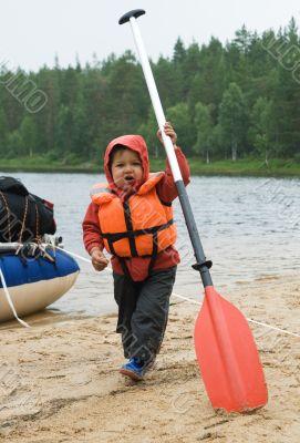 Little boy with an oar