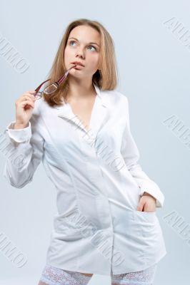 sensual female blonde doctor in whites