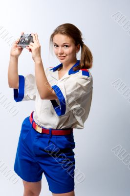 smiling pretty blonde female sailor with camera