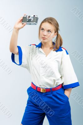 pretty young blonde female sailor with camera