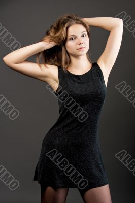 pretty young blonde with lifted hands in dress