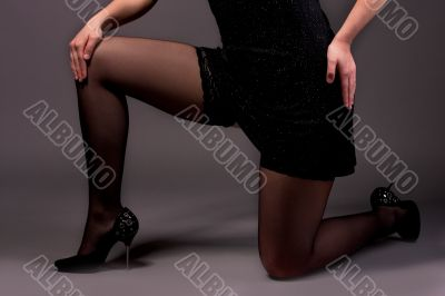 leg of young sexy female standing on knees