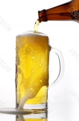 Beer flows from a glass bottle4