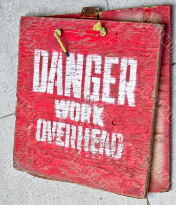 Red Danger Sign with words `Danger Work Overhead`