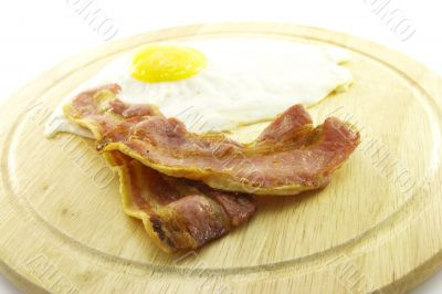 Bacon and Eggs on Wooden Plate