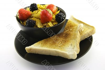 Cornflakes in a Black Bowl with Toast