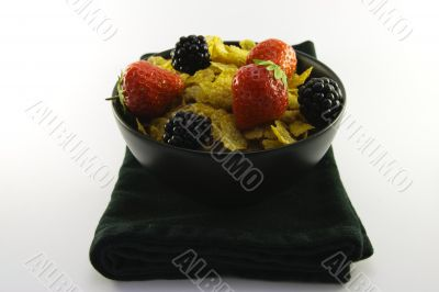 Cornflakes and Fruit in a Black Bowl