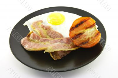 Bacon, Eggs and Tomato on a Black Plate