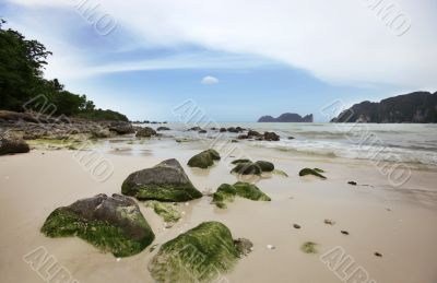 Big stones on the sand tropical beach