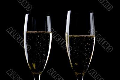 Two glasses champagne on black macro