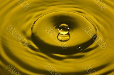water splash in yellow
