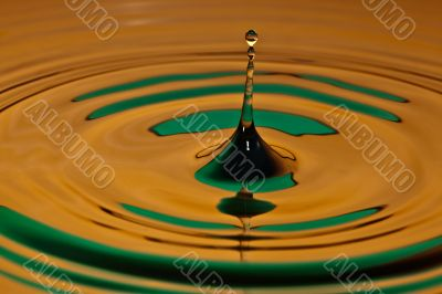 drop bouncing off a water surface