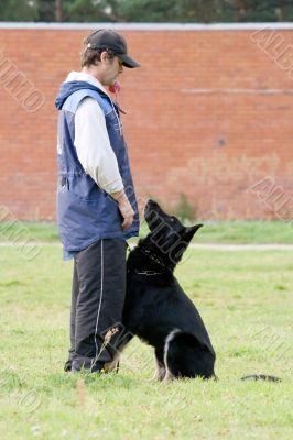 Man and Black German shepherd