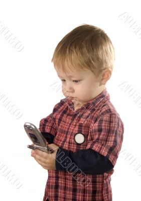 Small boy is browsing the snapshots on phone