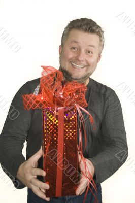 Attractive smiling man with present