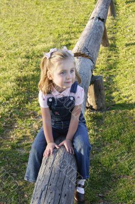 Small Girl Sitting on Log