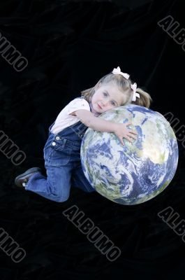 Three Year Old Girl with Earth