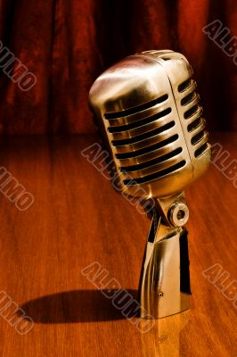 Retro microphone and red curtains