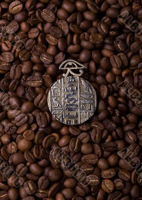 Ancient medalion on a coffee beackground