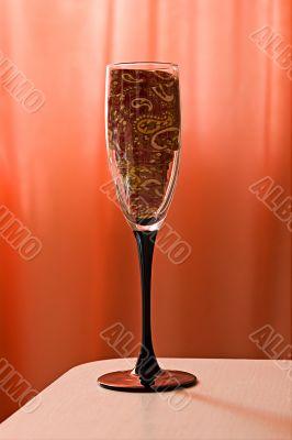 Champagne glass with a tie inside
