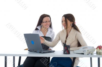 Two business woman work with laptop