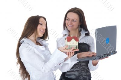 Two business woman advertises real estate