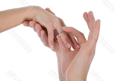 Man`s and female hands with a wedding ring