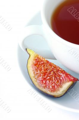 Tea cup and fig fruit