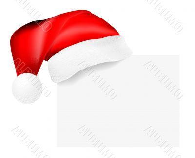 Santa`s cap hanging on a blank card