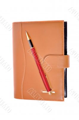 Planner and red pen