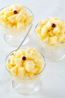 Three pineapple desserts and spoon