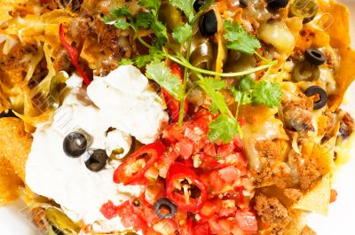 fresh nachos and vegetable salad with meat