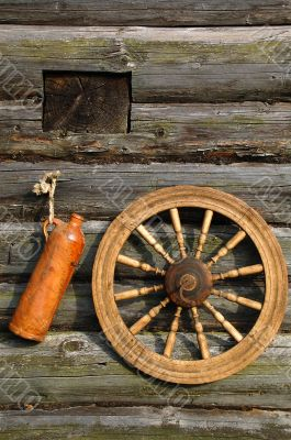 Ceramic Bottle And Spinning Wheel On The Wall