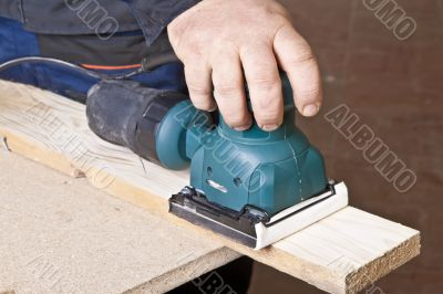 Work with sanding machine