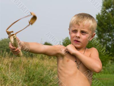 Boy with a slingshot.