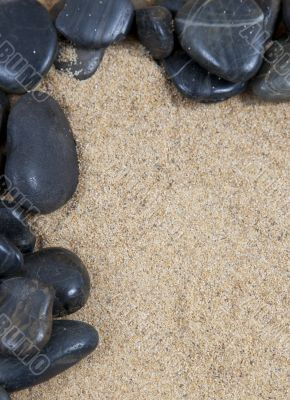 zen spa river rocks on sand in form of border