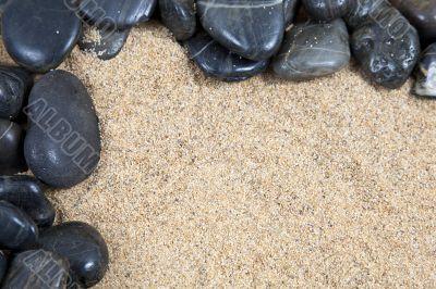 zen spa river rocks on beach sand