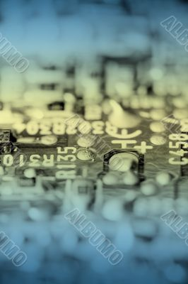 Close up of retro electronic circuit board, toned.