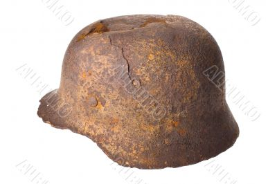 German rusty military helmet on a white